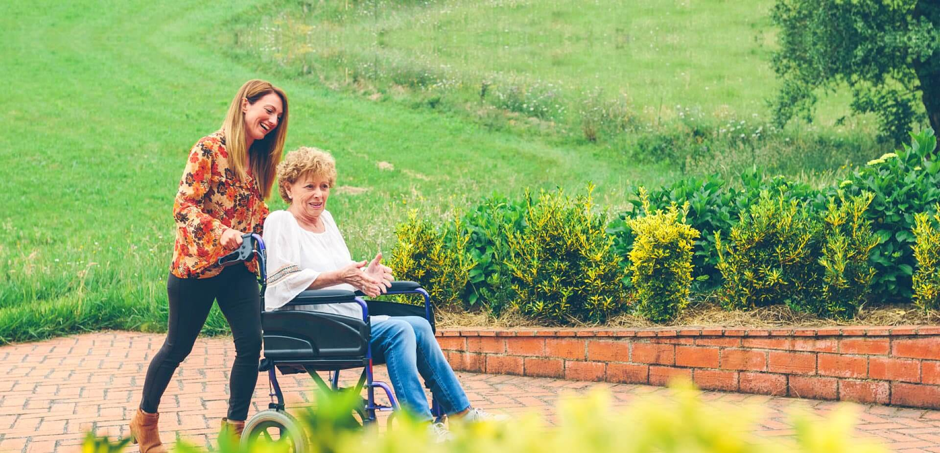 caregiver and patient walking in the park
