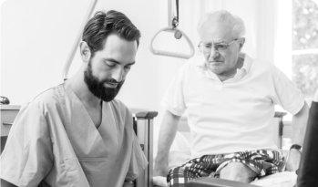 caregiver massaging patients feet