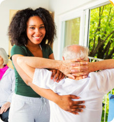 caregiver doing physical exercise to patient