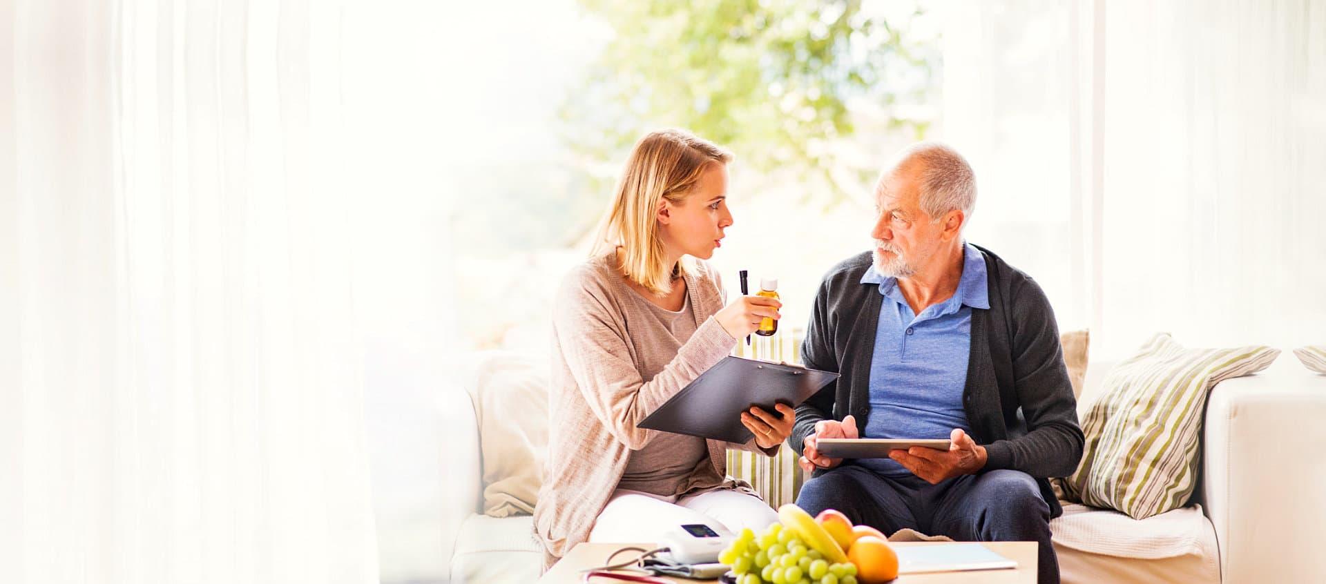 caregiver giving medicine to patient